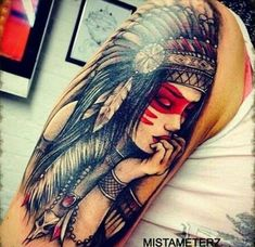 A girl with a headdress, a native American inspired sleeve tattoo in Gothic style.