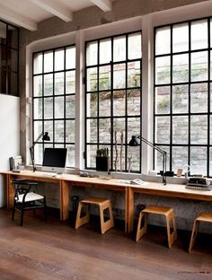 an industrial space with a windowsill turned into a long desk