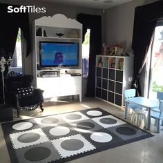 Modern Designer Kids Playroom using SoftTiles Circles Foam Play Mats. Most kids play mats are brightly colored. With SoftTiles you can create your own mat like this one that uses SoftTiles Circles in Black, Gray, and White
