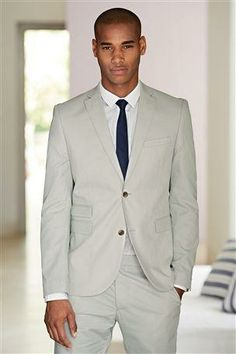 A well fitting suit is a man's wardrobe staple and this shiny one ...