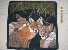 Foxes in the Den, hooked by Barbara Leduc