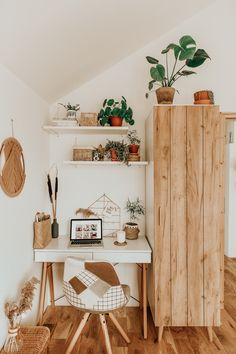 contemporary bohemian small home office work area wall shelves patch chair houseplants