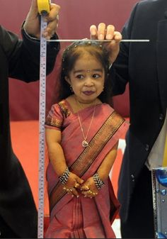 Jyoti Amge, Ma Petite in AHS Freak Show. At just 23 inches in height and weighing 11 pounds on account of achondroplasia, Amge is officially the world's smallest woman. Her role as the doomed Ma Petite is her first step into acting, which she says has always been her dream. Prior to American Horror Story, Amge was a contestant on Big Boss, India's equivalent of Big Brother.