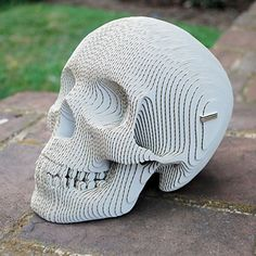 'Vince Cardboard Human Skull' is a build-your-own skull sculpture from Cardboard Safari. Made of recycled, laser-cut cardboard, the product is shipped flat, and Cardboard Sculpture, Cardboard Paper, Sculpture Art, Cardboard Relief, Cardboard Model, Cardboard Crafts, Cardboard Animals, Memento Mori, Modelos 3d