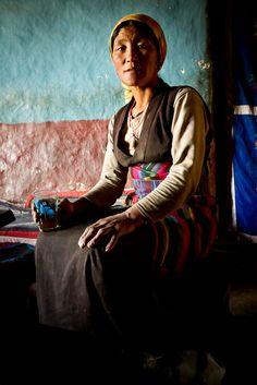 Woman drinking tea - Upper Mustang, Nepal