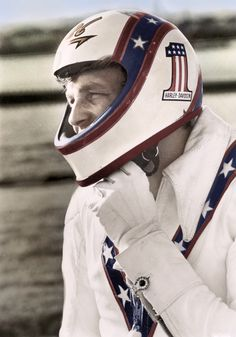 "A great shot of Evel Knievel showcasing the beauty of his white leathers with navy and red trim. Knievel was buried in a leather jacket like the one you see here when he passed away in 2007. Pal Matthew McConaughey offered this eulogy– ""He's forever in flight now. He doesn't have to come back down. He doesn't have to land."" And yes, McConaughey was probably stoned. A bit of an odd pairing if ever there was one, but I ask you– Who doesn't love Evel Knievel?"