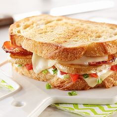 Loaded Baked Potato Grilled Cheese, stuffed with bacon and tomatoes on fresh sourdough bread.