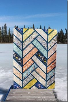 This is Terry's Broken Herringbone quilt and the pattern is by Violet Craft.  I love the fabrics she used but don't know the name of the collection.  She asked for simple quilting so I thought this wo