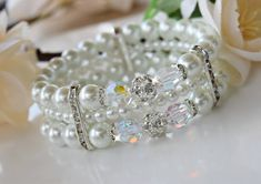 Pearl bracelet is made with 8mm swarovski crystals, glass pearls and crystal spacers. Perfect for weddings or other formal occasions