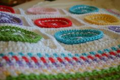 Ravelry: Bright as a Button Blanket pattern by Susan Carlson