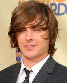 Zac Efron's Wispy Medium Hair with Dramatic Bangs from the 70s 2017