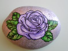 Painted stone. Rose