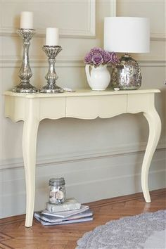 When a table is damaged beyond repair on one side, cut off the bad side and attach remaining half onto a wall to be used as a console table.