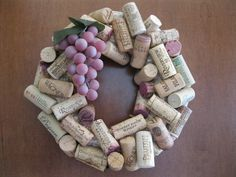 """After I completed the """"Cork Wall"""" I still had all of these corks left in my wine box: So, I bought a straw wreath: ....and made a """"cork wre..."""