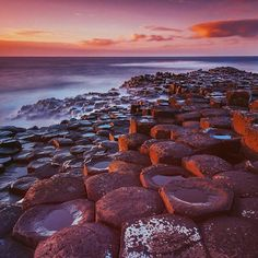 theplanetdA late evening glow on the steps of The Giants Causeway in Northern Ireland.  ----------  It is one of those places that is filled with legend and lore but no matter how these basalt columns were formed this wonder of nature it is amazing.  -------  If you love our travel photography make sure to check out our friends at @beautifuldestinations for more stunning imagery.  -------  #ireland #northernireland