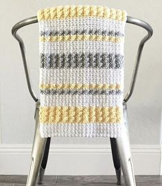 This is a free crochet pattern for a Crochet Gray and Yellow Bobble and Mesh Stitch Blanket. Made with 100% cotton and 100% love. I can't stop holding this crochet bobble and mesh stitch blanket and hope the baby that eventually is cuddled up in this feels warm and happy.