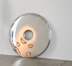 Stainless Steel Donut Mirror.