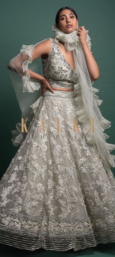 Buy Online from the link below. We ship worldwide (Free Shipping over US$100)  Click Anywhere to Tag Smoke Grey Lehenga In Heavily Embroidered Net Along With Ruffle Dupatta Online - Kalki Fashion Smoke grey lehenga in net heavily embroidered with thread, sequins and cut dana work in floral and checks pattern.Paired with a matching sleeveless choli in net with floral jaal embroidery.Designed with V neckline and V cut back Pakistani Outfits, V Cuts, My Wardrobe, Lehenga, Dress Up, Neckline, Sequins, Smoke, Gowns