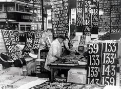 Preparing new London bus numbers, September 1934.