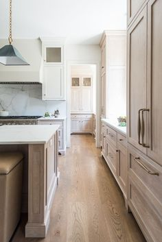 Cream color cabinets and wood flooring in kitchen