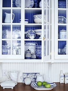 white cabinets with blue beadboard interiors