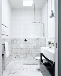 Combination of marble and white tiles. Nice i think . Look at The shower from the roof #carrara #bathroom #badrum #marmor