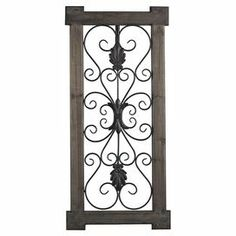 "Evoking French provincial style, this lovely wall decor showcases scrolling metalwork in a distressed gray frame.    Product: Wall decorConstruction Material: Wood and metalColor: Distressed grayDimensions: 41.5"" H x 19.5"" W x 1"" D"