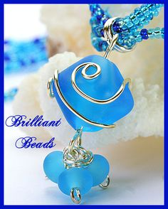 I love how the aqua glass etches!  http://brilliantbeads.net/item_887/Aqua-Silver-Wire-Wrapped-Lampwork-Beaded-Necklace-SRAJD.htm