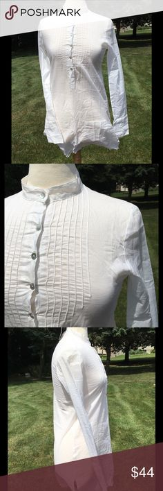 """Gorgeous White Tysa Tunic Dress NWT, white Lysa tunic top with pleated front and buttons about 1/3 of the way down. Very lightweight, 100% cotton, has the look of an old school night shirt. Very pretty! Tag says size """"0"""" and would probably best fit a small. Has left front pocket. Can be used as a cover up at beach too. Armpit to armpit measures approx 17.5""""; shoulder to bottom is 33.5"""" Tysa Dresses"""
