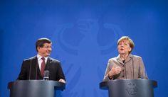 """Merkel mit dem türkischen Ministerpräsidenten Ahmet Davutoglu: """"Der Islam gehört zu Deutschland"""", but not Chrstians lol... http://www.spiegel.de/politik/deutschland/bild-1012635-797948.html"""
