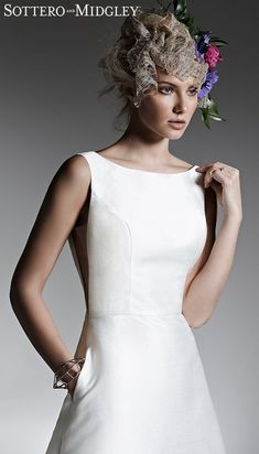 1920s wedding dress on simple a-line silhouette on tea lenght, bateau modest neckline and pockets | Affordable Wedding Dresses - Sottero-McCall-Lane-21SZ441-Main-IV - Belle The Magazine #weddingdress #weddingdresses #bridalgown #bridal #bridalgowns #weddinggown #bridetobe #weddings #bride #dreamdress #bridalcollection #bridaldress #dress See more gorgeous bridal gowns by clicking on the photo