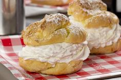 Cream Puffs  1 cup water 1/4 cup (1/2 stick) butter, softened 1/4 teaspoon salt 1 cup all-purpose flour 4 eggs, at room temperature 1 egg yolk 2 tablespoons milk 2 cups (1 pint) heavy cream 1/3 cup confectioners' sugar, plus extra for sprinkling 2 teaspoons vanilla extract