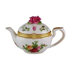 I do have an obsession with trinket boxes and teapots. :-]