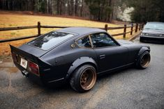 Tricked out Datsun Z. Flat black and rose gold were made for each other. Fender flares and reeally stretched tires over big wheels.