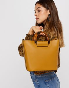 Created in premium PU with on-trend resin handles, our Lucy handheld bag will elevate any casual outfit. It fastens with a magnetic clasp and features a remo. Beach Accessories, Fashion Accessories, Back To School Bags, Gold Statement Earrings, Anklet Jewelry, Jewellery, Accessorize Bags, Star Jewelry, Flip Flop Shoes