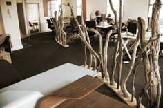 In this office space, the working areas are cycled by elements from the seashore, carefully chosen driftwood are curving around the desks, creating a sense of individuality, letting the light to spread out in space and a small kitchenette brings the sunrise theme into the space. Design by Studiomyrtle