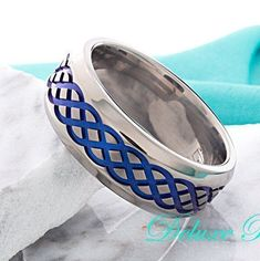 Titanium Celtic Wedding Band Mens Blue Celtic Knot Ring Anodized 8mm Beveled Polished Anniversary Promise Engagement Mens Womens Comfort Fit by DeluxeBands on Etsy https://www.etsy.com/listing/256232417/titanium-celtic-wedding-band-mens-blue #menweddingrings