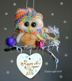 ♥️Hello and thank you for visiting my shop.  This listing is for the owl in the photographs, a needle felted buddy.  It is made with the needle felting technique using 100% sheep wool. Hours of hard but enjoyable work.  The eyes are made of plastic, and its tiny legs and beak are made from polymer clay.  Its size is 11 cm x 11 cm approx and fits in the palm of your hand.  You can order personalized bird : Wishes Greetings,Date of Birth.....