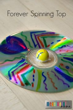 CD and Marble Forever Spinning Top - DIY fidget spinner made by kids - Great kid craft