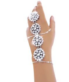 Moon flowers  Sparkling clear and very pale blue crystal flowers make up this amazing slave bracelet. Magical in every way and truly