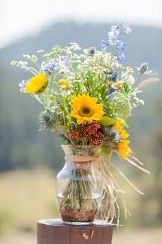 Summer wedding centerpiece idea - boho blue wildflower flower arrangements with sunflowers {Alison Rose Photography}