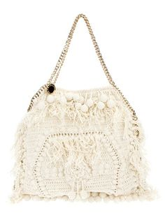 Cream cotton fringed crochet large 'Falabella' tote from Stella McCartney featuring a gold-tone chunky chain edging with a tonal leather whipstitch trim, two chunky chain top handles with designer embossed sperical disc and a concealed press stud for closure. Internally the bag has one zip fastening pocket, a pouch pocket and is lined in cream designer twill.