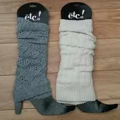 Two pairs of legwarmers The gray pair is  a thin material and the cream pair is a thick cable knit material Accessories Scarves & Wraps