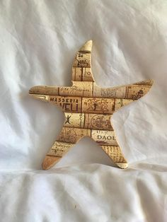A rustic oriented wino beach lovers perfect wall decoration! These are made to order. A variety of wine corks are arranged on a wooden starfish cut out. The wooden base is made of thin cut birch that has been stained a dark brown. Measurements: 7 x 7 1/2 Please keep in mind that these