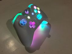 This is a Modest Advantage Xbox One controller with a full color changing LED mod including the shell underglow. It is an authentic microsoft controller and is only taken out of box to be customized