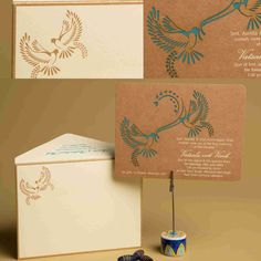 Lasercut Doves and lovebirds. On envelope printed and embossed the love bird design