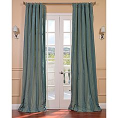 Striped Taffeta Zuma Curtain Panel  Like the drapes, but don't like them to puddle on the ground.  Dust and cat hair catchers.
