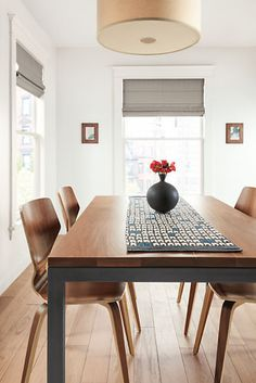 This graphic table runner features a design inspired by archeological objects. Block printed by hand in Philadelphia, the 100% linen fabric adds texture, color and pattern to your home. It is scaled to fit neatly down the center of common dining table sizes.