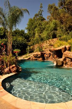 Pool with beautiful landscaping and natural features