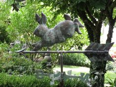 A folk art weather vane points the way...weather vanes are always neat in the garden!! Love this!!